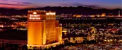 Aerial view of Sunset Station Hotel & Casino with orange and red sunset