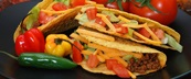 Hard shell tacos with fresh peppers