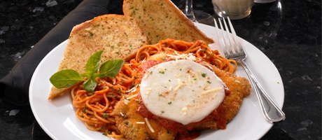 Chicken parmesan with a slice of fresh mozzarella, angel hair pasta,and garlic bread