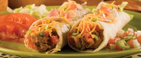 Two beef soft tacos with cheese, pico de gallo and tomato slices