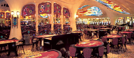 Blackjack tables at Sunset Statio with the Gaudi bar and ceiling in the background
