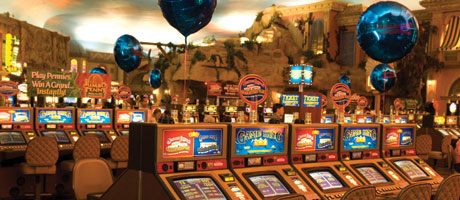 slot machines with blue mylar balloons above